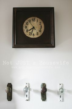 old door knobs as towel hooks. Love the clock in the bathroom also!