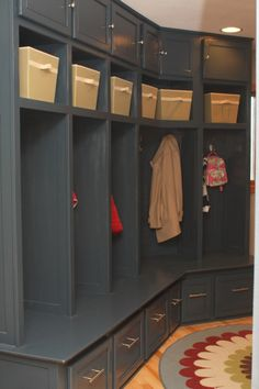 Custom Black Mudroom Cabinetry - lockers like storage on top and bottom have 4?