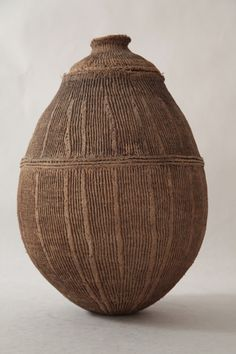 Old Turkhana String Jar, Ethiopia An old Turkhana jar made of twisted cord in a vertical pattern covered with hardened clay and a fitted lid...
