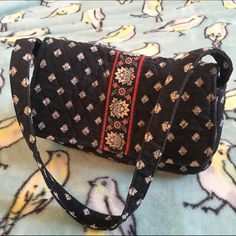 """Vera Bradley Vintage purse small black red This is vintage it has light wear and is a bit faded. It has fabric on the zipper pulls instead of the usual because it is vintage. Check out my other Vera Bradley listings. This is a small shoulder bag. Base 2.5""""x9"""". Strap drop 9.5"""". Height 4.5"""". Inside zip pocket fits an iPhone 6. Vera Bradley Bags Mini Bags"""