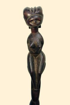 Tanzania, Luguru wood, reddish brown patina, traces of black paint, crowned by a female figure with voluptuos thighs and pointed breasts, coiffure with broad neck lobe, dotted tattoos    Read more: http://www.tribal-art-auktion.de/en/catalogue170/d100_201/#ixzz38OI8NiSV