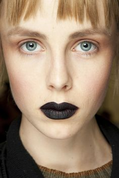 GilesAt Giles, Lucia Pieroni painted lips a gothic black, whilst skin was matt, eyes contoured and lashes left bare of mascara.