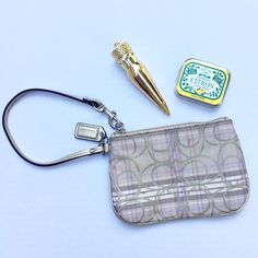 """Coach wristlet The colors on this are so delicate and pretty!  Lavender and beige with gold monogram.  Measures 6 1/2"""" X 4 1/2"""".  EUC- Tiny mark as seen in last photo.   🎉Make an offer!!🎉 💰Bundle discount is on!!💰 Coach Bags Clutches & Wristlets"""