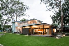 A modern extension to an Art Deco house references and respects the original while providing th...