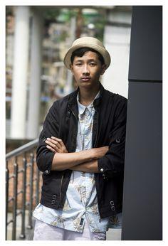 TheQuirkyMinimal by Kangkan Rabha for Farfetch Apple Music partnership wearing Vintage Prada jacket, Old Navy Printed shirt, Thrifted DIY pants, Black Vans via Jabong, Levis Hat