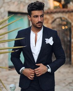 - with a summer outfit idea with a black pinstripe suit white banded collar shirt white cotton pocket square wrist accessories watch Best Wedding Suits, Wedding Dresses Men Indian, Wedding Dress Men, Mens Fashion Suits, Mens Suits, Men's Fashion, Suit Guide, Black Pinstripe Suit, Best Street Style