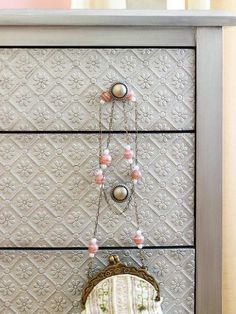 Faux Finish. Textured Wallpaper applied with decoupage and painted over. Then sealed with decoupage.