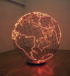 """In London and Berlin-based Palestinian artist Mona Hatoum's sculptural work titled """"Hot Spot"""", we are presented with a massive cage-like metallic globe radiating a crimson glow. In terms of global pol (Diy Photo Lighting) Living In London, Deco Design, Globe Lights, Neon Lighting, Lighting Design, Lighting Ideas, Hallway Lighting, Bedroom Lighting, Home And Deco"""