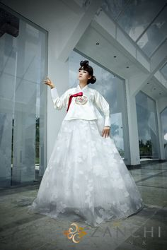 It's fusion style of modern wedding style and Korean traditional dress. I think it would be cool to wear hanbok style wedding dress.