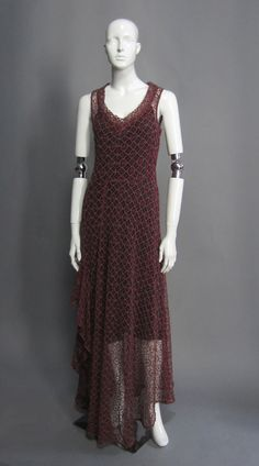 """MEASUREMENTS: Shoulders - 15"""", Bust - 30"""", Waist - 30"""", Hip - 46"""", Length - 60"""" FABRIC: Lace SIZE: 40 LABEL: DRIES VAN NOTEN DETAILS: The stunning burgundy and blue grey ornate lace is unlined. The dr"""