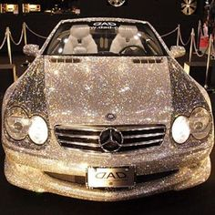 A swarovski crystal covered mercedes. Who comes up with these things! #mercedes #swarovski crystals