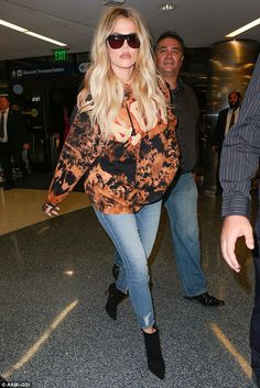 Casual: The 32-year-old reality star dressed down as she arrived at the departures section...