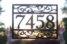 This is a custom made address sign from Seattle, Washington. I am selling the FIRST ONE PICTURED. *** You tell me what text you want on the sign, then I create the sign and ship it to you! *** The sign in the picture is made from 14GA steel and measures approximately 17 wide x 13 tall *** It can come with a lip with holes for mounting on top of something or it can have mounting holes on the main body of it for mounting directly onto your home (please tell us during checkout if you want the…