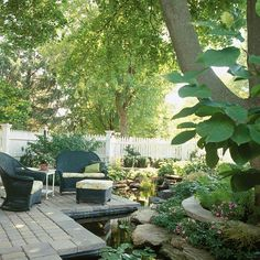 A relaxing water garden turns this pretty patio into a backyard oasis. See more ideas for outdoor spaces: http://www.bhg.com/home-improvement/porch/outdoor-rooms/outdoor-room-ideas/?socsrc=bhgpin042313watergarden=4