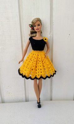 Handmade clothes for Barbie doll in. by my own design. Crochet dress made from yellow yarn in combination with black yarn. The dress is decorated with crocheted flower. Doll and shoes is not included. Crochet Barbie Patterns, Crochet Doll Dress, Crochet Barbie Clothes, Black Crochet Dress, Doll Clothes Barbie, Barbie Dress, Doll Clothes Patterns, Crochet Dresses, Clothing Patterns