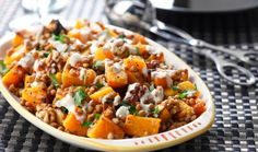 41 medium butternut squash, peeled, seeded, cut into 1-inch pieces 2-3 Tbsp(30-45 mL) canola oil salt and pepper, to taste 1-19 oz (540 mL) can lentils, drained and rinsed 1⁄2 cup (125 mL) walnuts, toasted 1⁄2 cup (125 mL) crumbled goat cheese 1⁄4 cup (60 ml) tahini (sesame seed paste) juice o...