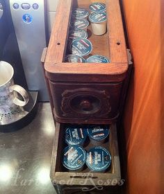 K-Cups stored in old sewing machine drawers.