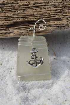 Genuine frosted white sea glass Christmas ornaments with silver anchor charm. Genuine frosted white sea glass ornament. Dress up your Christmas tree and bring memories of warm summer nights and beach walks with this lovely Christmas ornaments.  The sea glass is real frosted beach glass that was collected on the sandy shores and rocky beaches of Casco Bay, in Coastal Maine. The beach sea glass was carefully selected for both its unique shape, thickness and its color. Each ornament is handmade…