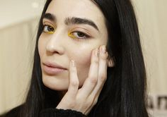 Gold-striped nails at Delpozo fall 2015