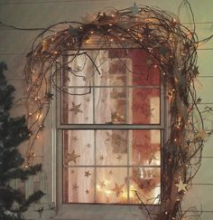 Rustic touch Christmas window decor with grapevine garland, lights and stars. Pic by texas Favourite & Country Treasures Noel Christmas, Primitive Christmas, Country Christmas, Winter Christmas, All Things Christmas, Xmas, Christmas Fireplace, Christmas Lights, Primitive Decor
