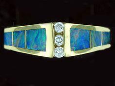 .06 carat tw. diamond, Blue Austrailian Opal cabachon, 14k yellow gold John Bagley designer ring