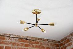 5 arm brass gold sputnik style mid century modern inspired starburst matte black and gold raw brass modern chandelier five 5 arm pinwheel bulb aloadofball Choice Image