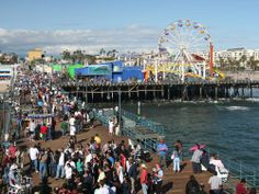 Santa Monica, CA. The Pier is a throng of humanity, but everyone should experience it once in their life. The town of Santa Monica is filled with beautiful streets that roll through canyons and wonderful shopping districts. Activities In Los Angeles, Santa Monica California, Southern California, Los Angeles Hollywood, Secluded Beach, Ocean Park, Hermosa Beach, Beautiful Streets, City Of Angels