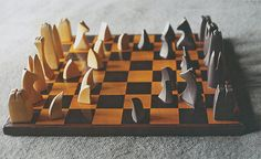 """Abstract Chess Set, 1942, boxwood and ebony Wharton Esherick """"I am still a victim of chess. It has all the beauty of art—& much more. It cannot be commercialized.""""—Marcel Duchamp"""