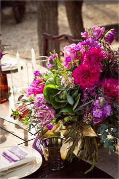 pink and purple wedding flowers #purpleweddingflowers #purplewedding #weddingchicks http://www.weddingchicks.com/2014/01/14/deep-purple-wedding/