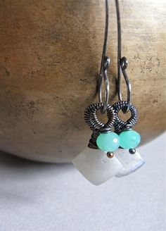 The Articidia earrings - grey moonstone and chrysoprase rondelles finished with heavily oxidised sterling silver.  From realisationcreations on Etsy.