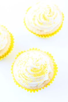 Lemon Curd Cupcakes Recipe on twopeasandtheirpod.com Lemon cupcakes filled with lemon curd and topped with buttercream frosting. Love these cute and delicious cupcakes!