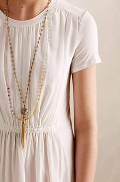 simple white dress + delicate layered necklaces (love this look for Thanksigiving dinner) #anthrofave