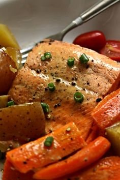 Instant Pot Lemon Butter Garlic Salmon with Homestyle Vegetables–flaky wild Alaska salmon is steamed on the top of red potatoes and carrots in your electric pressure cooker and drizzled with garlic, fresh lemon juice and butter. A one pot meal that is healthy and delicious! #onepotmeal #instantpot #instapot #pressurecooker #seafood #salmon #healthyrecipe