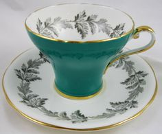 http://antiques2jewelry.com/Cup%20Saucer/aynsley%20teal%20green%20teacup%202.JPG