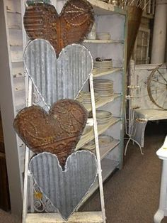 Tin hearts cut from vintage tin tiles and corrugated tin- Mustard Moon - inspiration only. for cards could make small ones out of corrugated cardboard? Metal Projects, Metal Crafts, Diy Crafts, Barb Wire Crafts, Paper Hearts, Valentine Decorations, Valentine Crafts, Valentines Hearts, Barn Tin