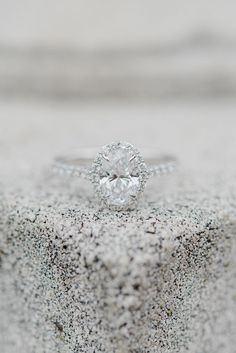 This oval halo engagement ring is what every girl dreams of!