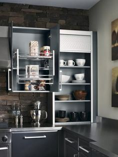 Overhead cabinets seem like a dream — until you have to pull out a step-stool every time you want the box of oatmeal. Solve that problem with an integrated pull-down shelf, which brings hard-to-reach items to you. Tip: Look for versions with assisted lowering/lifting mechanisms that lock into place in the down position.