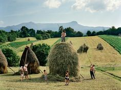 The Borca family, from the village of Breb, put finishing touches to one of the 40 or so haystacks they make each summer, Transylvania, Romania - by Rena Effendi Azerbaijani Champs, Ukraine, World Press Photo, The Farm, National Geographic Photographers, Lomography, Country Life, Photography Tips, Amazing Photography