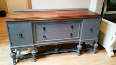 Antique sideboard refinished in a paris grey mix and American chestnut stain.