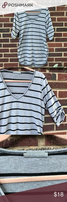 """Slouchy tunic top Very cute and comfy top. It's in good condition. The fit is loose and tunic length on me, but I'm 5'4"""" and typically wear a medium. Loveappella Tops"""