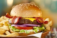 Classic Bacon Burger: A crowd-pleasing favorite, topped with applewood smoked bacon, cheddar, red onion and mayo. #Chilis
