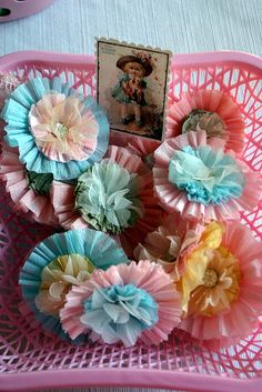 Crepe paper flower rosettes...and wouldn't they look great using tulle?