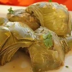 Artichokes are sauteed in garlic butter before steaming. A simple and delicious way to use artichokes! Vegetarian Recipes Easy, Vegetable Recipes, Diet Recipes, Cooking Recipes, Healthy Recipes, Healthy Meals, Vegan Vegetarian, Dessert Recipes, Healthy Eating