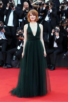 Emma Stone in an emerald green Valentino gown at the Venice Film Festival