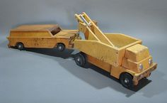 Two huge push toys: an unmarked (Creative Playthings?) towtruck pulling a Community Plaything's station wagon. Ca: 60's-70's. www.playfulplans.com