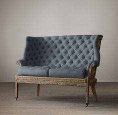 RH's Deconstructed 19Th C. English Wing Settee:Inspired by the unadorned beauty of their grandfather's 19th-century wing chair – liberated from its velvet upholstery and the frame exposed – the Van Thiels replicated the Old World artistry in the 19th C. English Wing Settee. A distressed walnut frame, accented with nail tacks, is complemented by the texture of burlap and fabric. This is furniture for the ages.