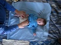 Cloth Diapering 101: how to change prefold diaper using a Snappi fastener and Bummis Cover