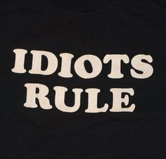 Vintage black t-shirt with 'Idiots Rule' on front. Not sure if this is at all associated with Janes Addiction Idiots Rule song from the Nothing's S Truth Hurts, It Hurts, Jane's Addiction, Vintage Tees, Shirt Shop, Vintage Black, Slogan, Tee Shirts, Sayings
