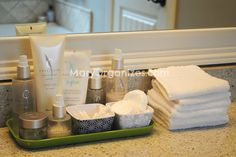 Keep a stack of wash cloths on bathroom counter. Each night dry your face with a fresh cloth, and then wipe the sink and counter down and put in hamper. Two wins: a spa feeling for you, a clean counter for all.