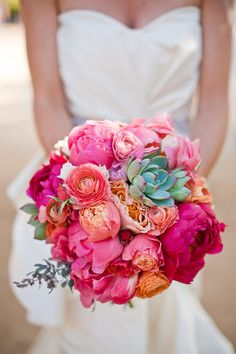 vibrant pink, peach and green bouquet -- loving the pop the succulent gives this arrangement. Would be really pretty with the bridesmaids having just succulent bouquets.